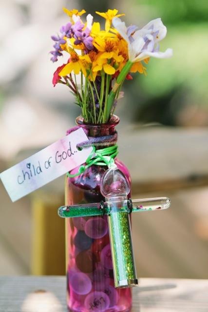 Child_of_God_vase_with_flowers.jpeg