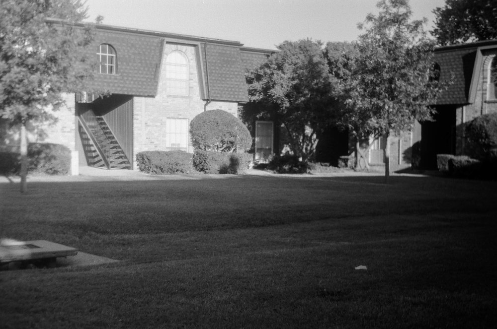 This was the courtyard we played football in all the time. The Trees were not there in the 80's. Zorki 4 | Ilford HP5