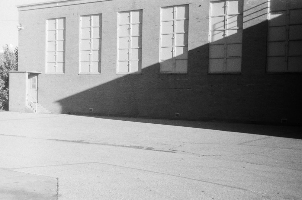 McLean Middle school gym wall. Lots of interesting things happen here very morning. 1980's Zorki 4 | Ilford HP5