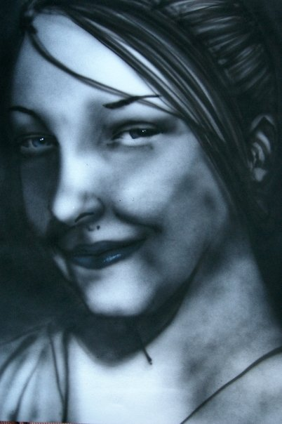 This was a complete freehand airbrush work based on my niece Courtney. The likeness is terrible, but whoever it turned out to be is pretty soulful. I was shooting ink, not paint, but it didn't flow well so it's kind of patchy. I like it how it has a more charcoal feel than the smoothness of airbrush work.