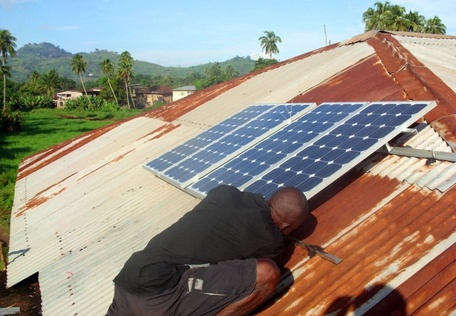 Installing Solar Modules in Makeni, Sierra Leone.