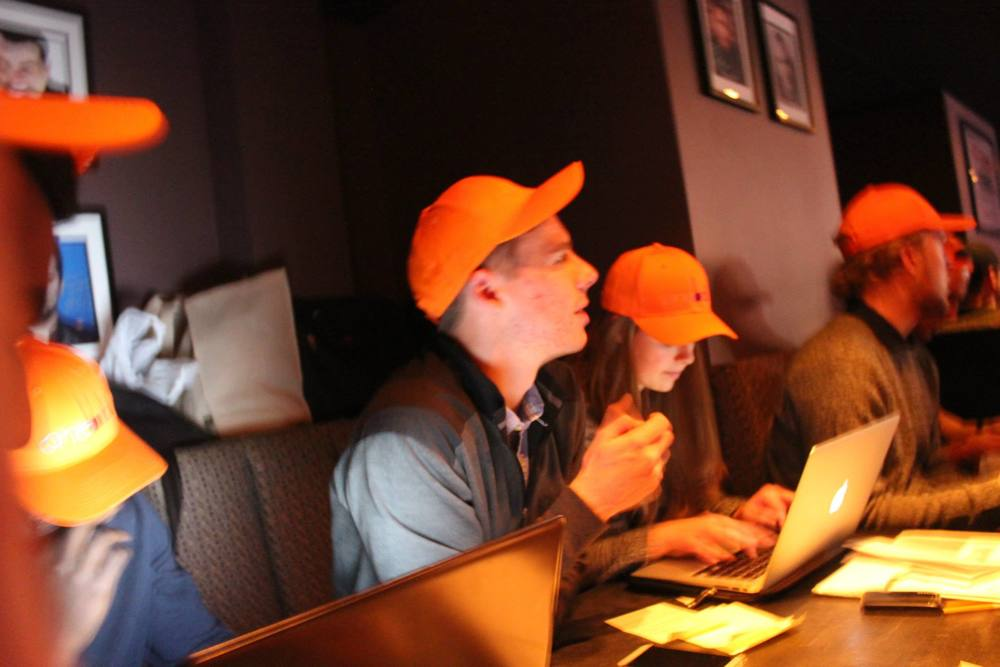 Oneball UCalgary hard at work, sporting our vivid Oneball hats.