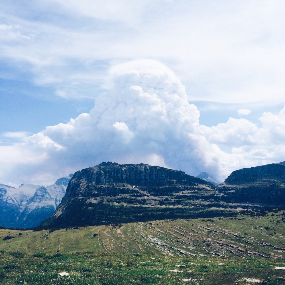 The smoke from a forest fire at Glacier National Park enveloping the clouds above.