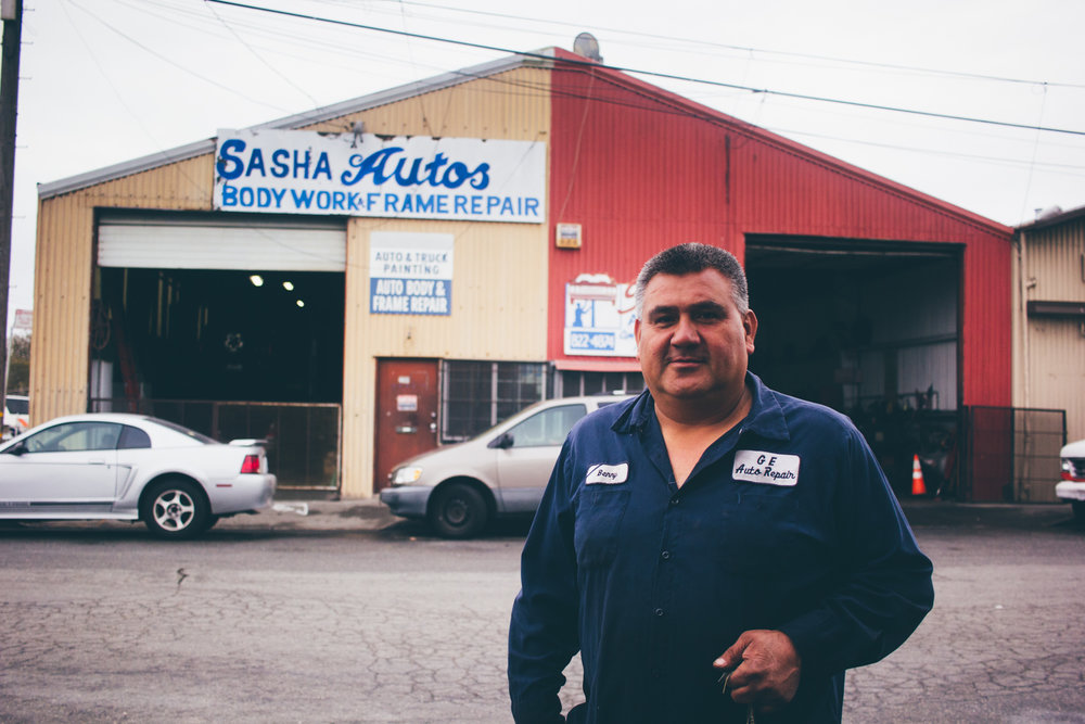 Benny, an auto mechanic, stands outside the shop where he works in the Hunter's Point neighborhood of San Francisco on Monday, Oct. 4, 2016.