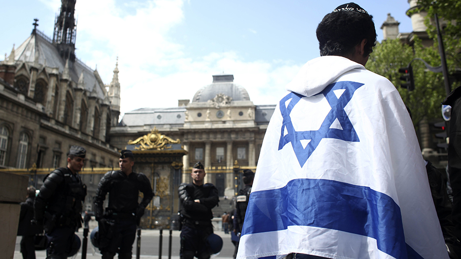 "A French Jew stands outside the Paris courthouse Wednesday April 29, 2009 during the trial of Youssouf Fofana, 28-year-old presumed leader of a group of 10 young women and 17 young men. Fofana, charged with participating in the torture and killing of a young French Jew took his seat in juvenile court Wednesday with the defiant declaration, ""Allah will be victorious."" The 23-year-old victim, Ilan Halimi was found naked, handcuffed and covered with burn marks near railroad tracks in 2006. (AP Photo/Thibault Camus)"