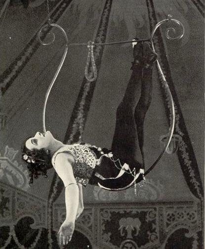"Circus performer Caedo in her ""lyre"" in 1893"