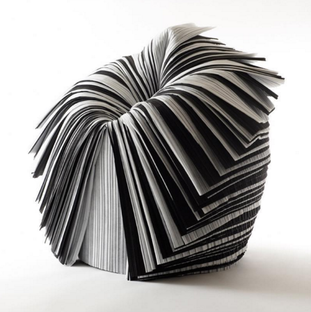 The Cabbage Chair created by Japanese designer, Nendo, was designed from the XX1st Century Man exhibition curated by Issey Miyake, who asked the designers to make furniture out of the pleated paper, usually abandoned as an unwanted by-product.    With no internal structure, paper is instead wrapped into a cylinder and cut vertically halfway down one side so the layers can be peeled back one at a time. The primitive design responds gently to today's fabrication and distribution costs and environmental concerns.