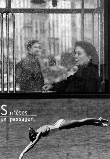 Image taken at roadside of passing bus in Paris by photographer Stephen Tilley