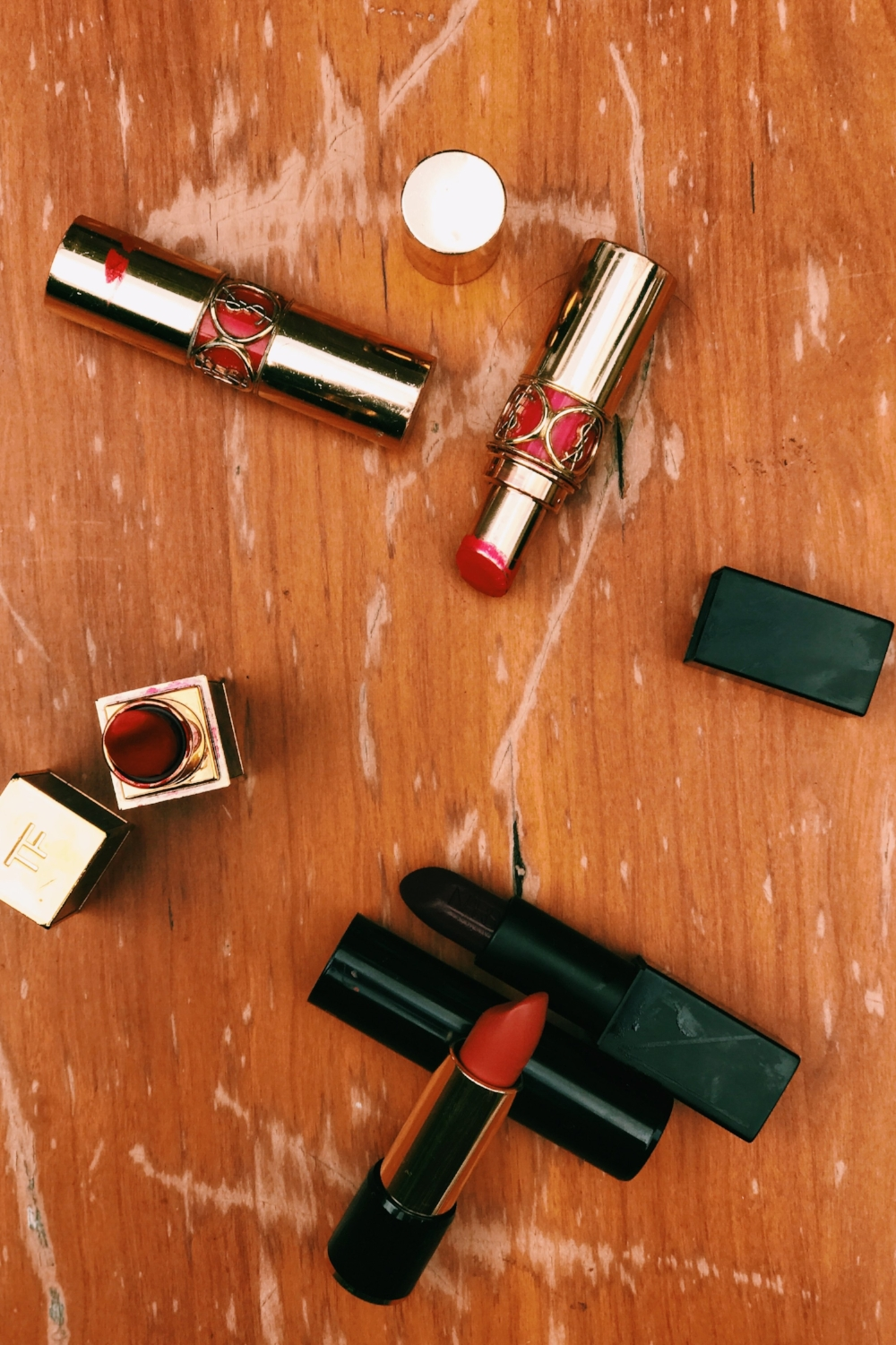 Sealed Lips. - YSL for creamy kisses and Tom Ford for matte and dry onesLancome L'Absolu Rouge Cafe Parisien for everyday desires and NARS for rebellious nights