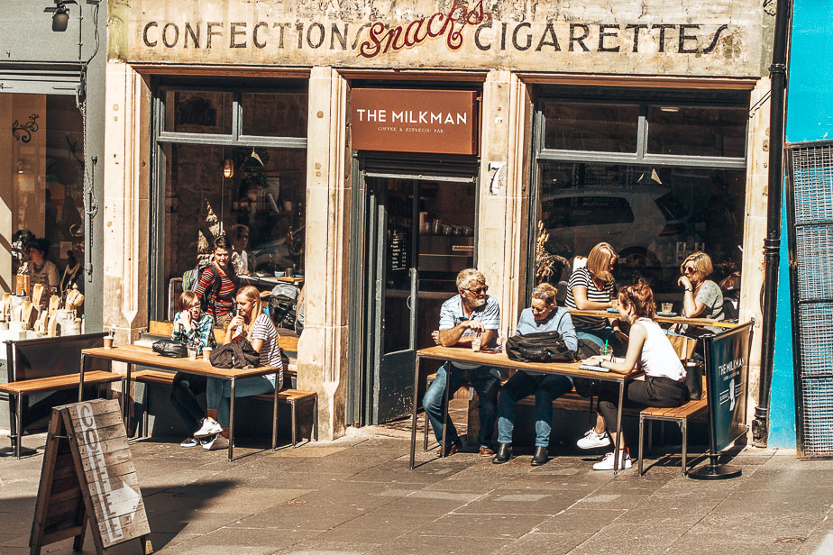 Customers-sitting-in-the-sunshine-at-The-Milkman-Edinburgh-Scotland.jpg