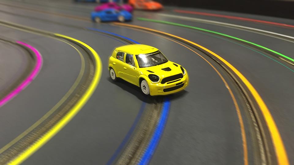 Mini cooper racing around the track