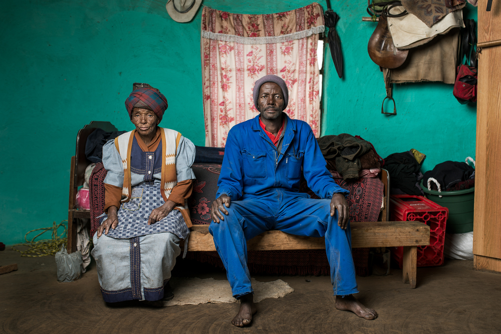 Xolisile Butu (with his mother Adelaide) worked in the mines for 7 years. He developed pulmonary TB and received R1000 compensation.