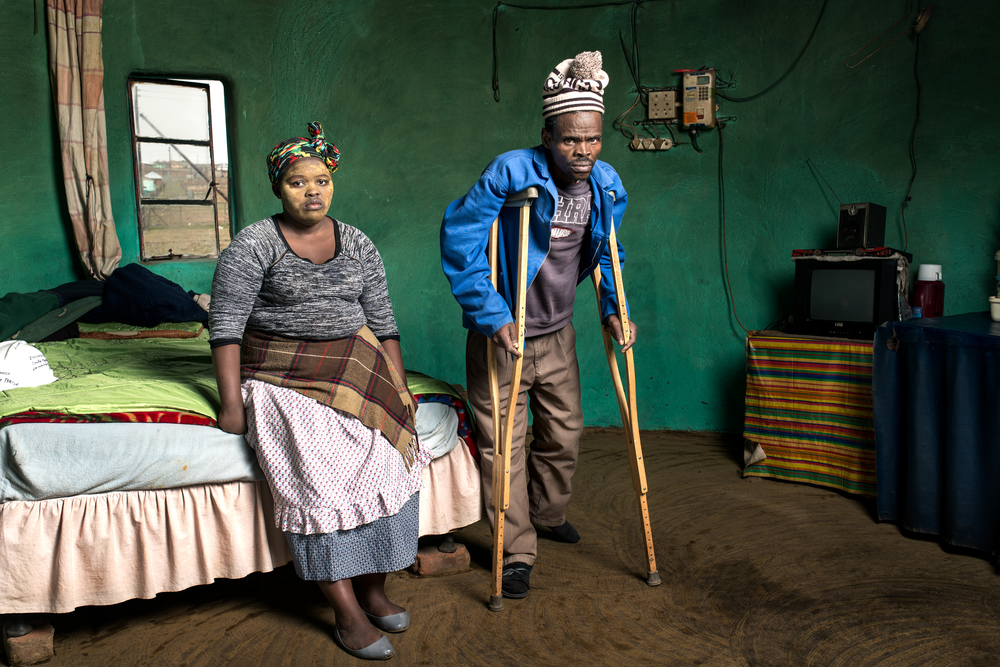 Patrick Sitwayi (with Asive Bingwa) worked in the gold mines for 22 years. He has silicosis and received no compensation.