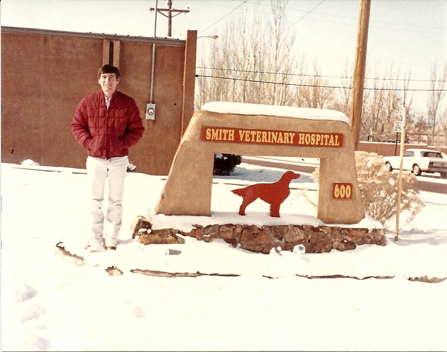 Dr. Mike in the snow outside of Smith Veterinary Hospital in its current location at the intersection of Alta Vista and Luisa streets.