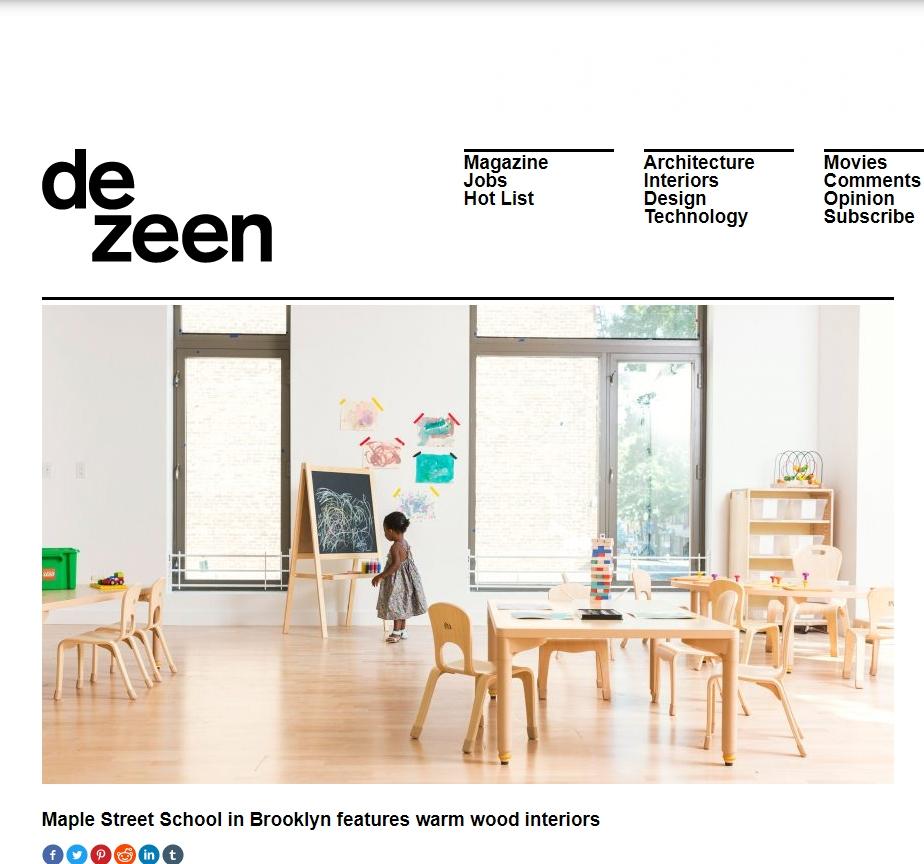 Maple Street School in Brooklyn features warm wood interiors.   DEZEEN. Dan Haworth.