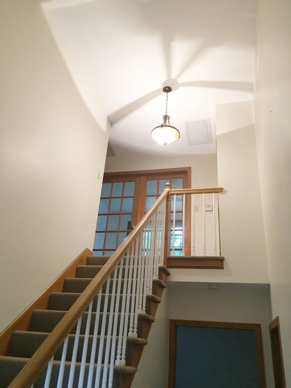 BEFORE - Entry Stairs with carpeting and light oak railing