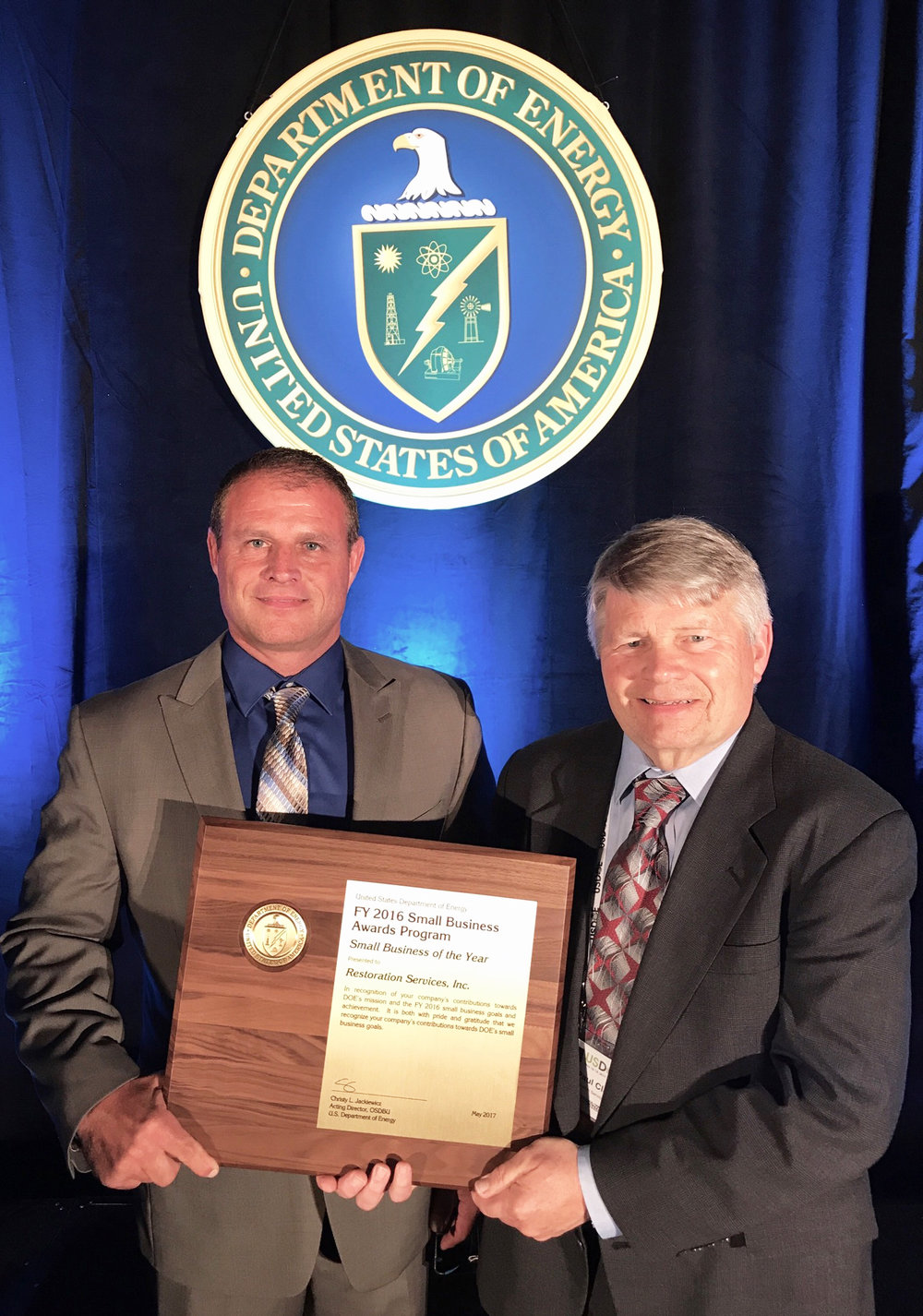 Greg Wilkett, ETS Program Director, and Paul Clay, RSI President, accept the Department of Energy (DOE) Small Business of the Year award for Fiscal Year 2016. RSI was recognized at DOE's 17th Annual Small Business Forum & Expo on May 17, 2017 in Kansas City.