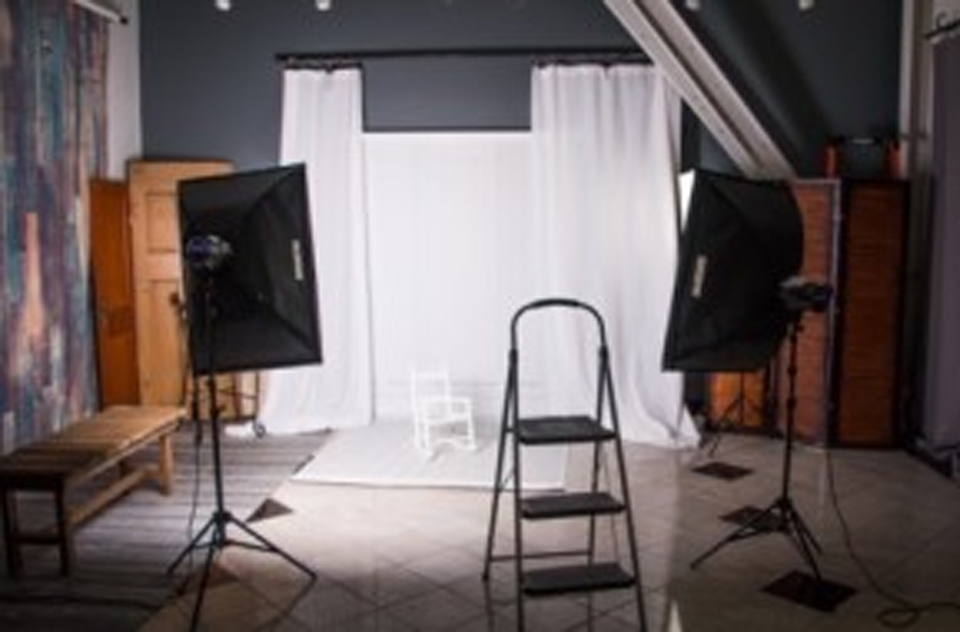 Conveniently Located in St Cloud. Large variety of Props and Backdrops. Studio Light Portraits.