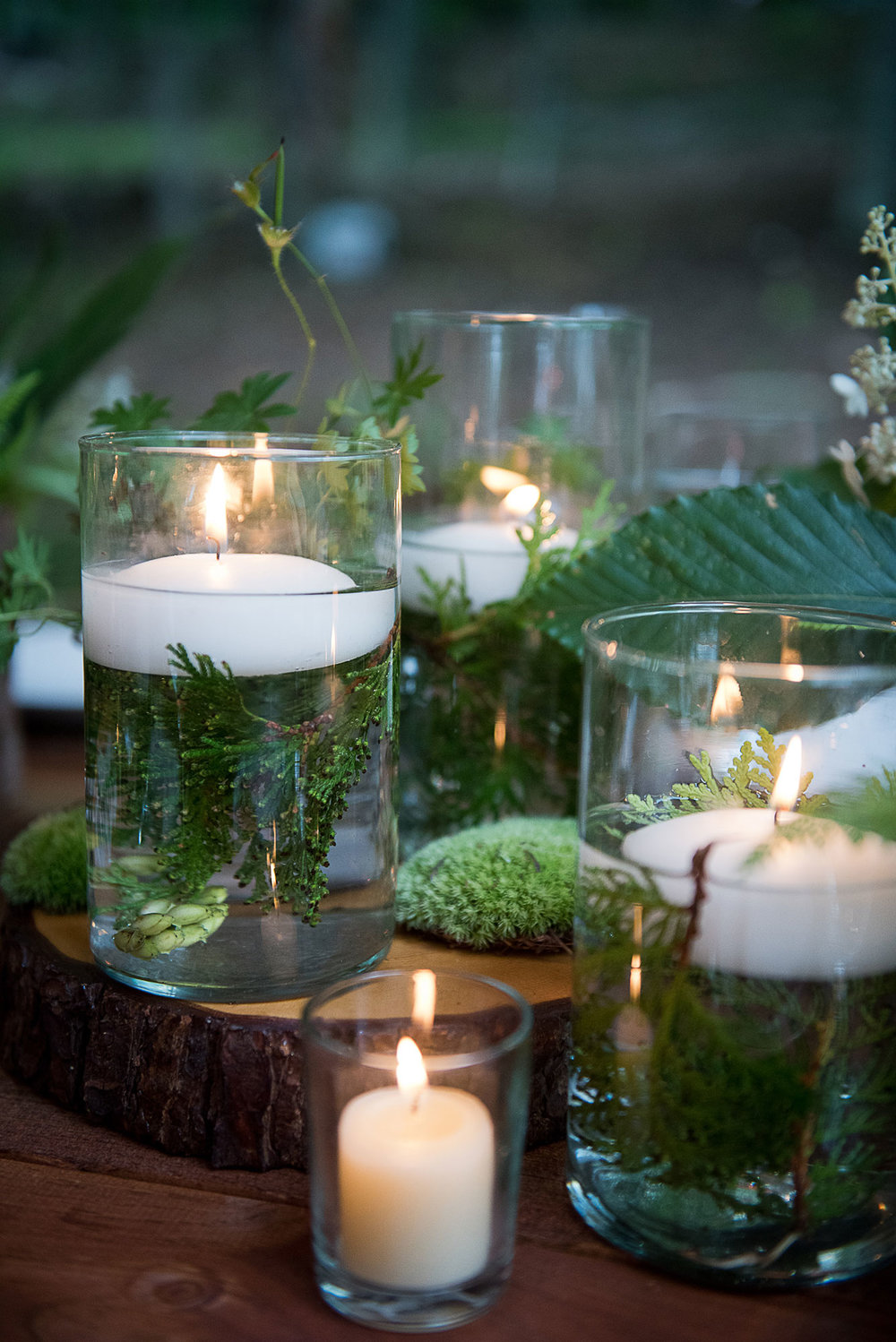 floating_candles_moss_cedar_arrangements.jpg