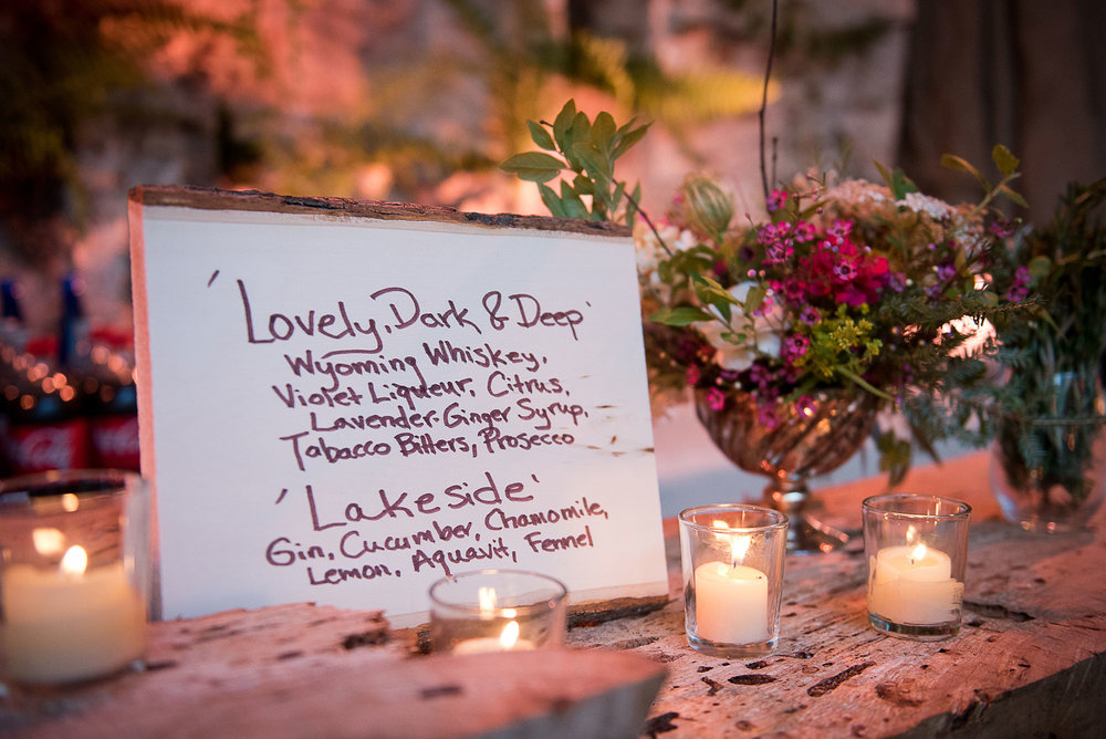 wedding_whiskey_sign_floral_centerpiece_candles.jpg