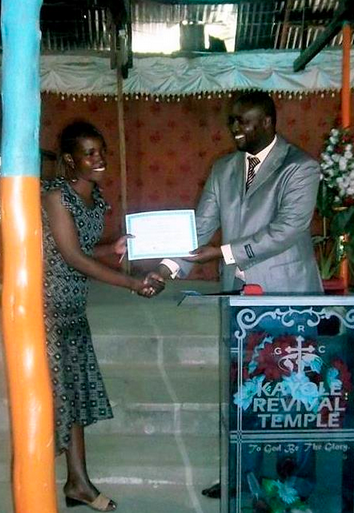 Monica receives her certificate from Duncan