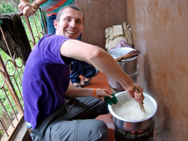 Helping a family cook ugali for dinner!