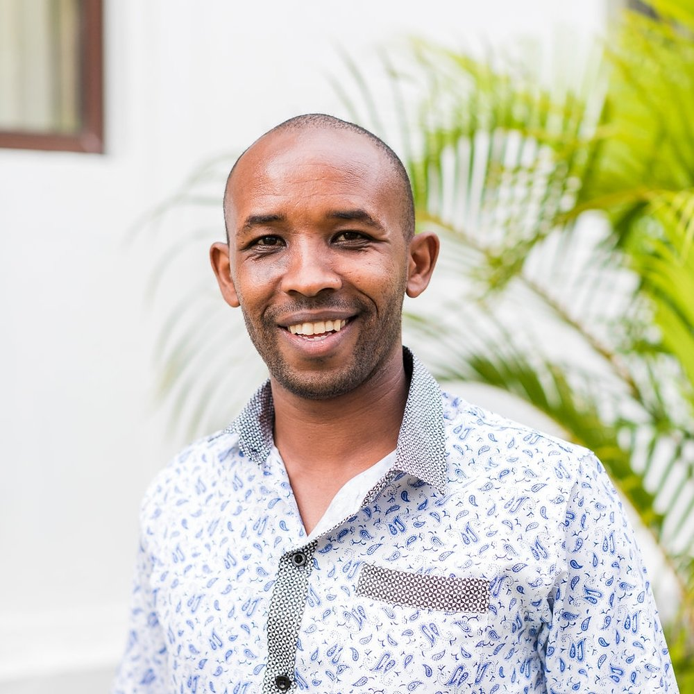 "- Spiritual Counselor: David Kutukai Tirike""I grew up in rural Masai land in Kajiadu county. A family with polygamy foundation, my father had four wives and I had very many step-sisters and step-brothers, totaling up to around 27. Our family was very poor."