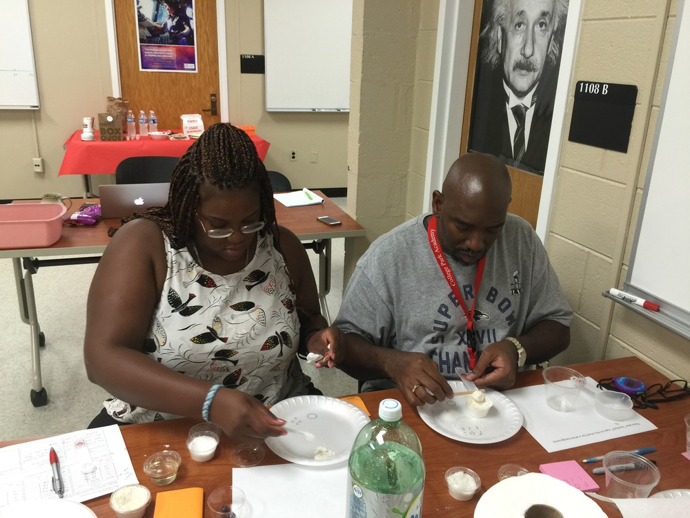 Photo:  Left to right; Holly Riley, Northwestern High School and Juan Foreman, College Park Academy, participated in the Learning Community Day for collaborating teachers.  Teachers performed the tasks with the lens of teachers and student learners.