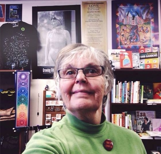 Susan Post among the many baubles, treasures, and magic housed at Bookwoman.