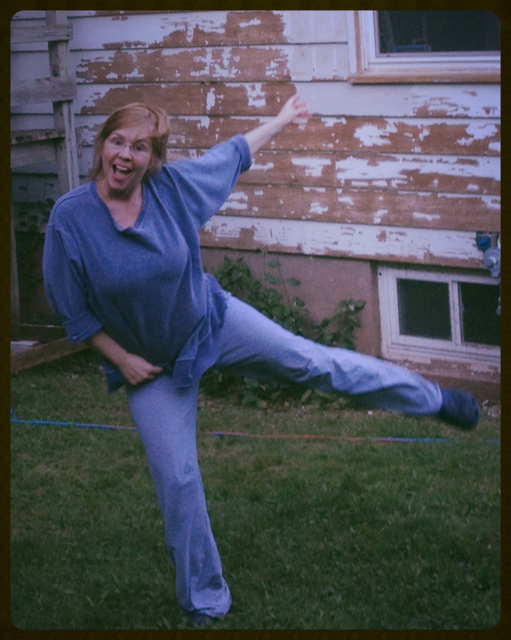 What photo goes with this blog post topic? There really isn't one, so here's a pic on the day I wrote it, yesterday. I'm hamming it up in front of the paint scraping progress on Fixer Upper #5. Whoooo!
