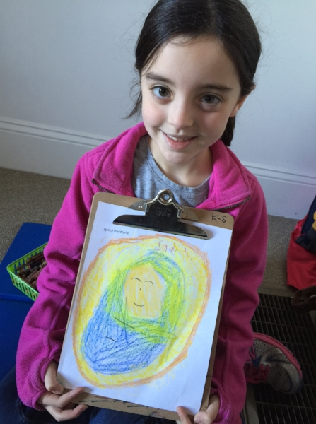 Young female student showing a drawing