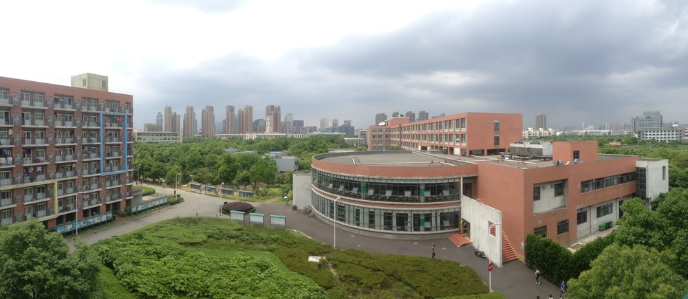 THIS WAS THE VIEW FROM THE BALCONY OF MY STUDENT ACCOMMODATION BUILDING. THE BUILDINGS IN THE FAR BACK BY THE TREES IS WHERE I HAD ALL MY CLASSES AND LECUTRES;THE OVAL BUILDING WAS ONE OF THREE CANTEENS ON CAMPUS; THE BULDING ON THE LEFT IS ANOTHER STUDENT ACCOMMODATION BUILDING.