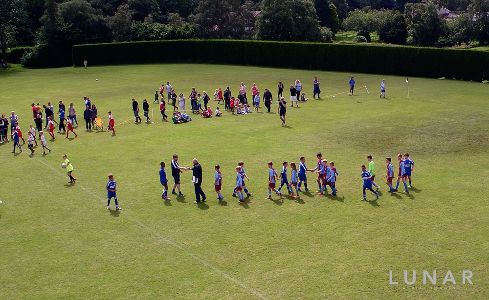 drone footage of soccer tournament northwest hands.jpg