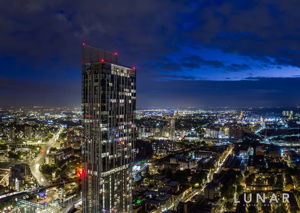 Aerial photo of Manchester at night with city lights