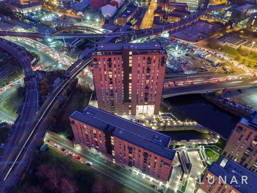 Night aerial view of road and train junction with Apartments