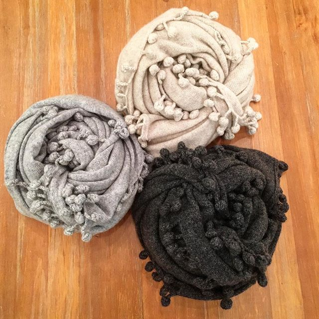We are in love with these new Pom-Pom cashmere scarves! Which color is your favorite? #cashmere #pompoms #style #fashion #accessories #winterfashion #shermanpickey