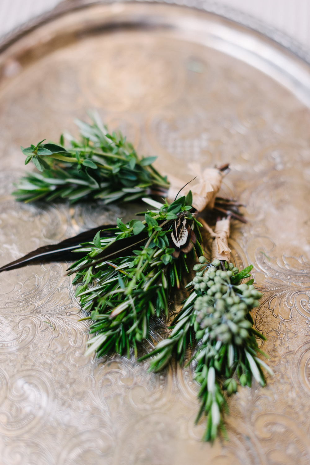 herb and feather boutonniere.jpg