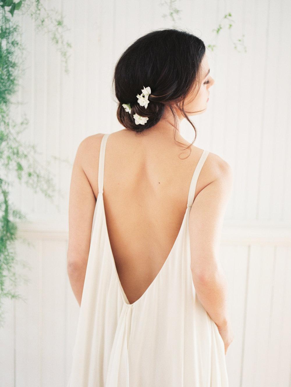 simple flowers in bride's hair.jpg