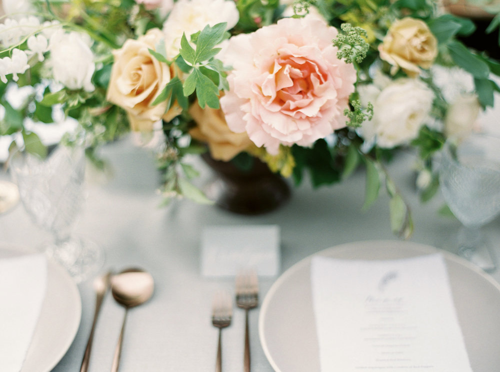 table setting for wedding with pastel floral centerpiece.jpg
