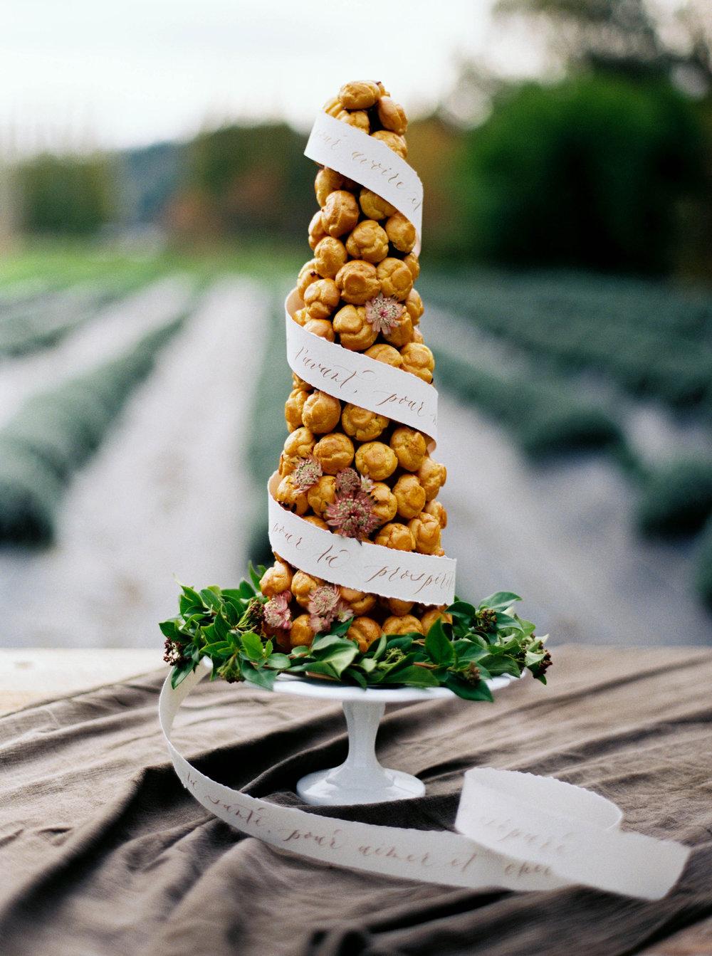 croquembouche wedding cake with flowers.JPG