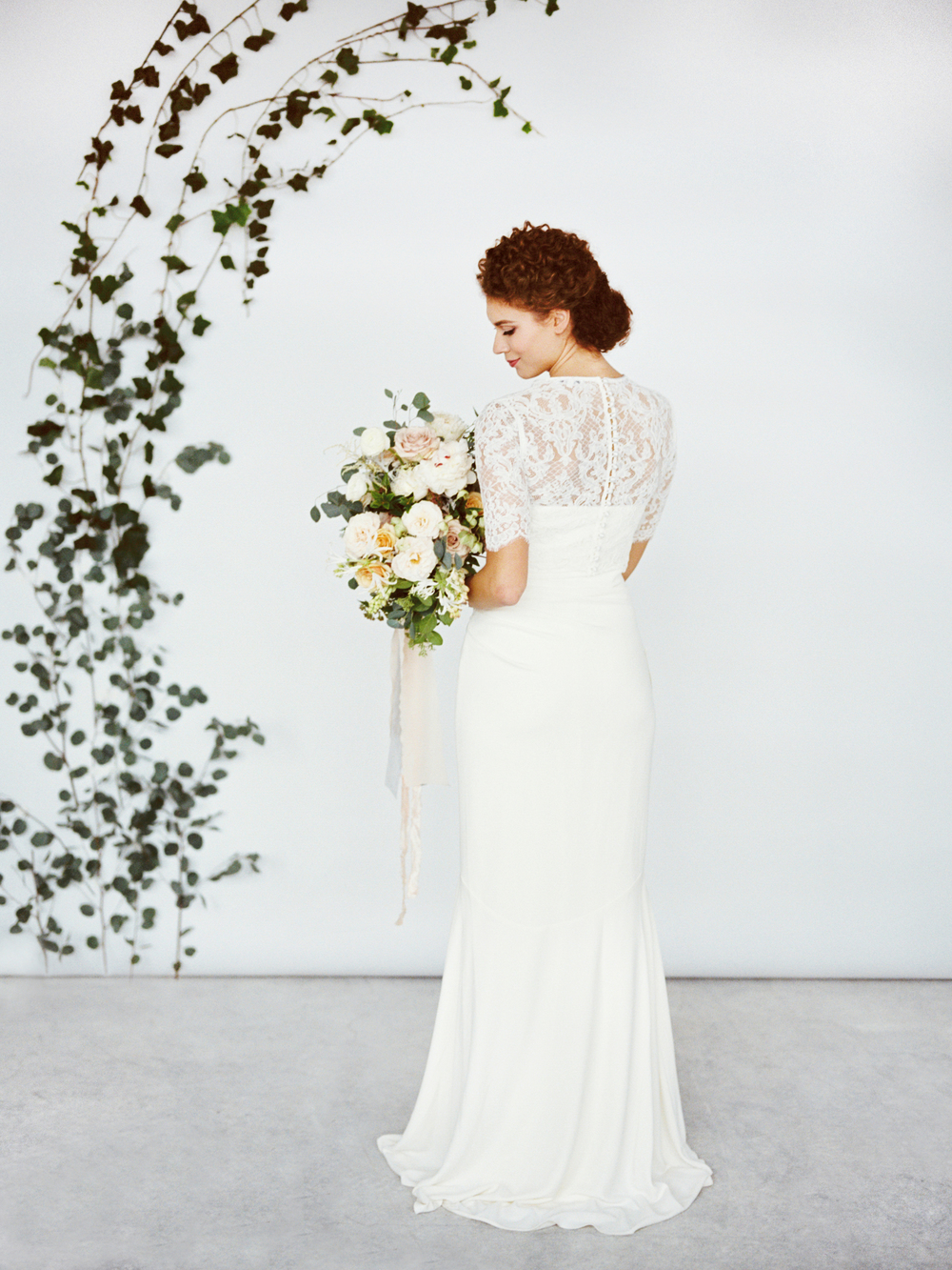 greenery backdrop and spring bridal bouquet.jpg