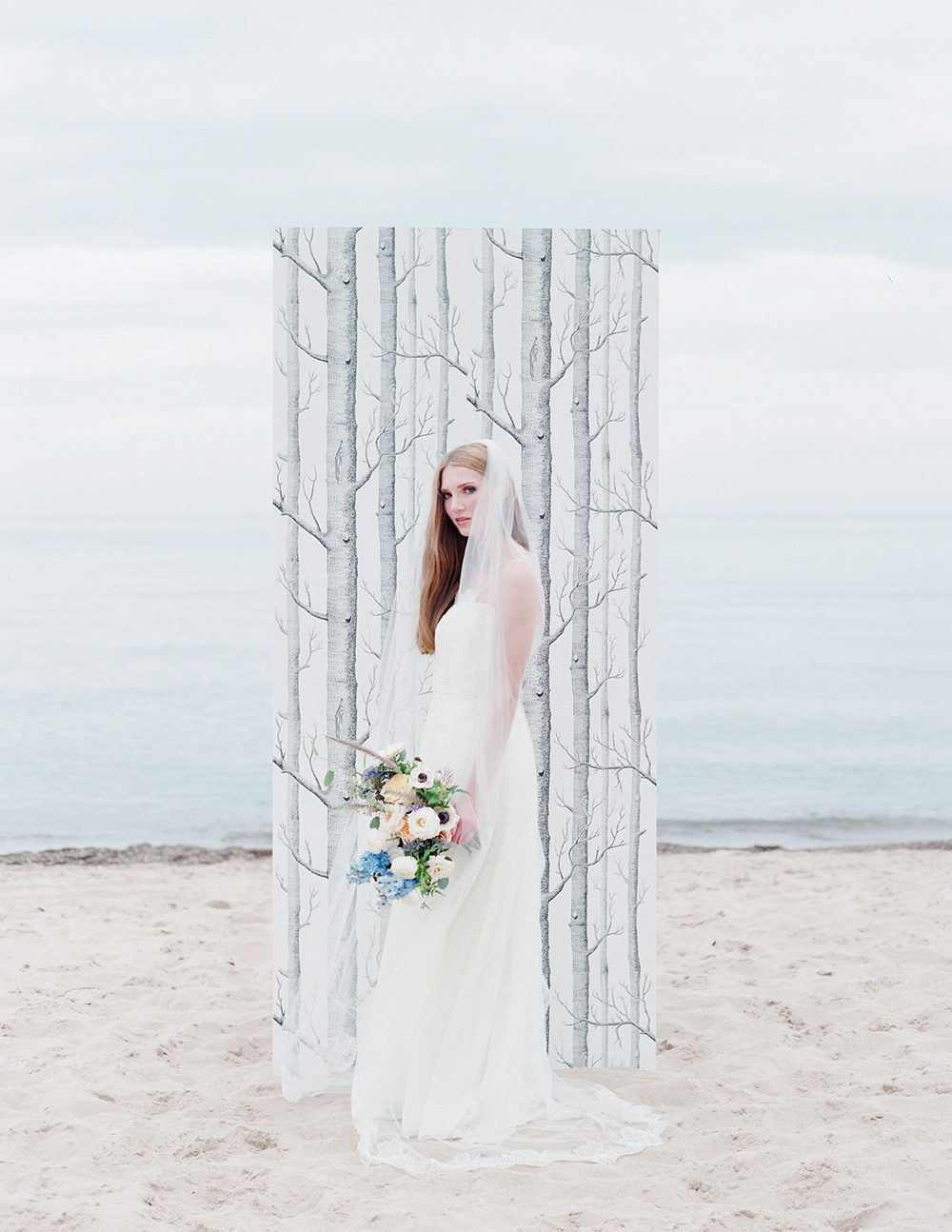 beach wedding flowers in peach and blue.jpg