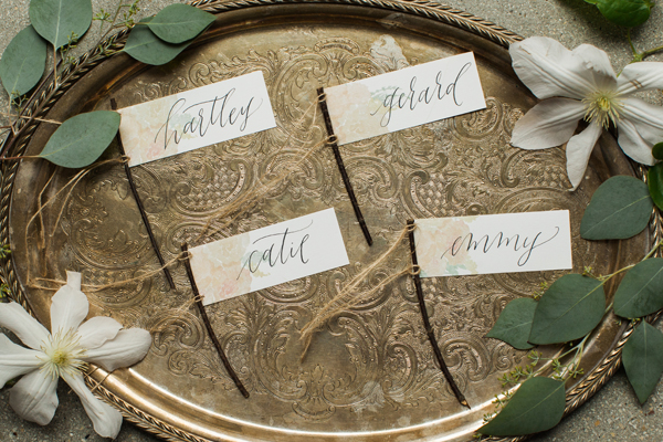 unique escort card ideas in calligraphy