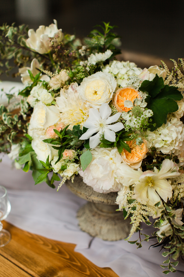 fresh flower wedding centerpiece with peach and white flowers by Foraged Floral in Portland, Oregon