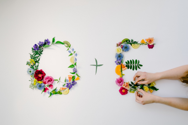 Flat styling for wedding with bright colored flowers and fruits by Foraged Floral in Portland, Oregon