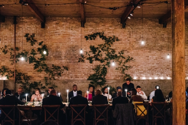 farm table wedding with industrial lighting and greenery backdrop at Gallery 1028 by Foraged Floral