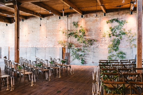 greenery wedding ceremony backdrop on brick wall at Gallery 1028 by Foraged Floral