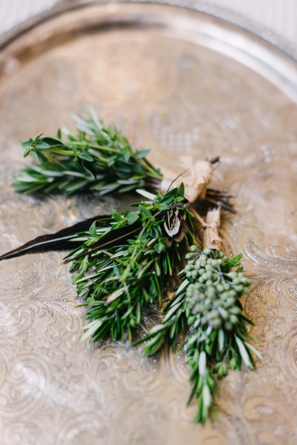herb boutonnieres made of rosemary, thyme and feathers by Foraged Floral