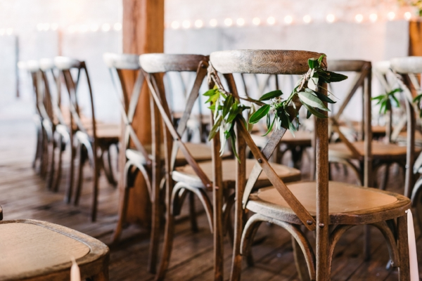 greenery on wedding altar chairs for wedding ceremony by Foraged Floral