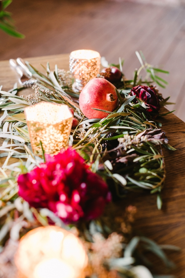 wedding table garland with burgundy peonies, ranunculus, fruits and fresh greenery by Foraged Floral